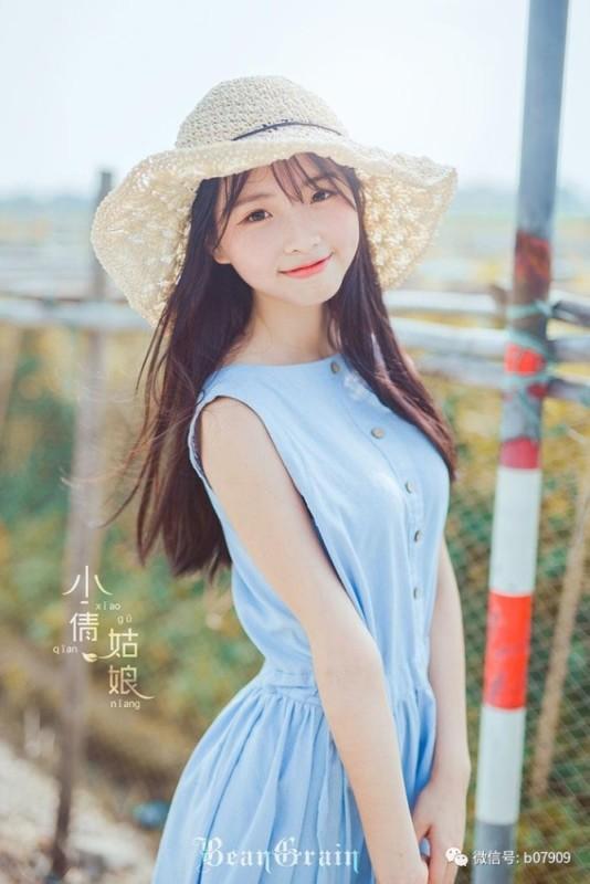 美女图片:清纯美女夏日室外可爱写真[多图]图片2