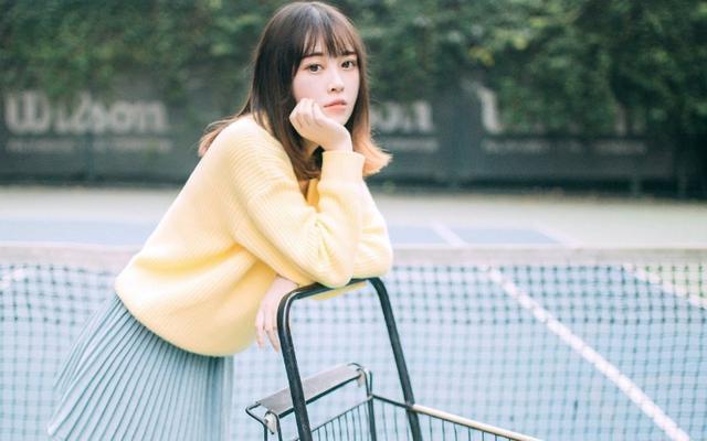 美女图片:小妹清纯甜美操场写真[多图]图片2